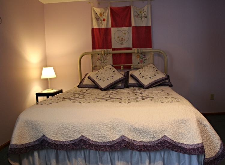 Lilac bed with lamp