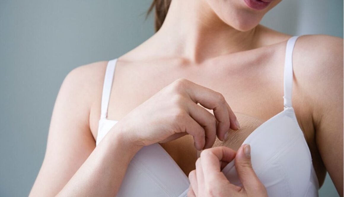 A flat-chested woman trying to increase her breast size.