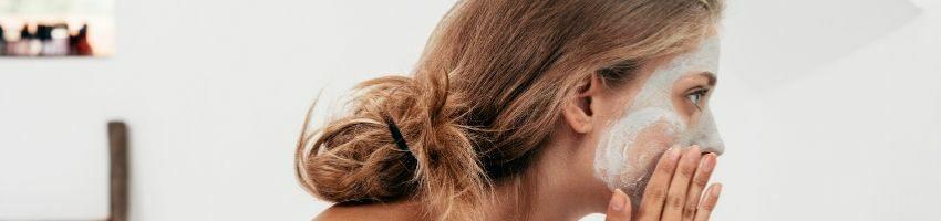 A woman exfoliating her skin.