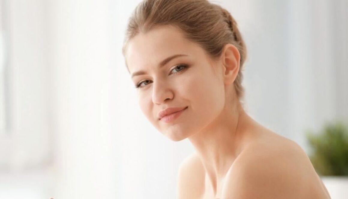 Female Applying Facial Moisturizer to her skin to prevent acne