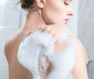 A woman using non-toxic body wash.