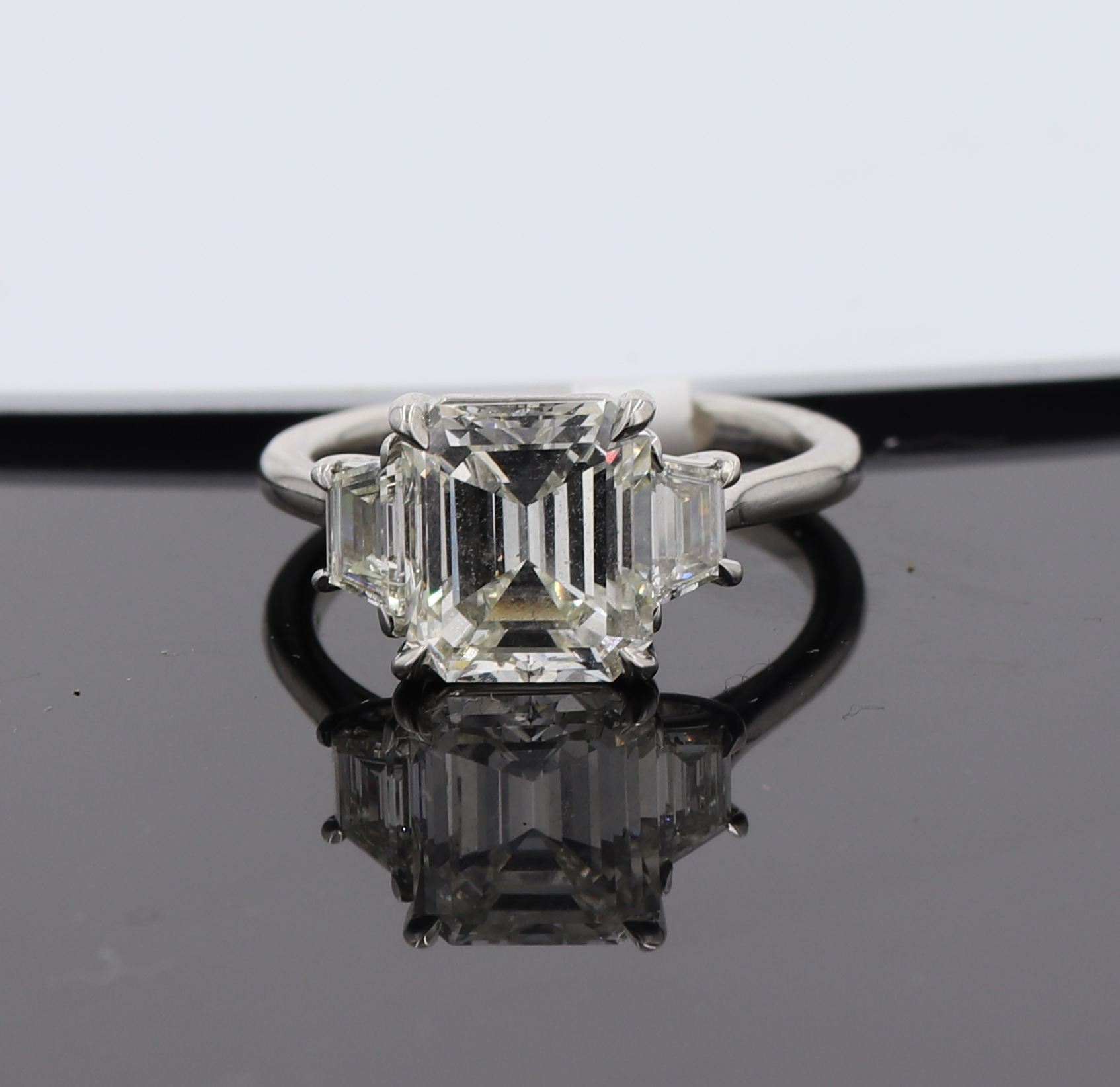 Platinum 3.02 CT Main Emerald Cut With Side Stones Engagement Ring