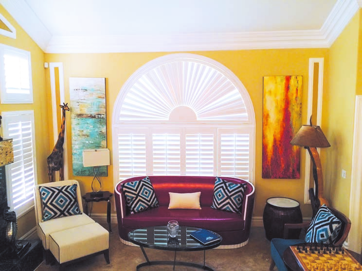 yellow living room shutters and arch