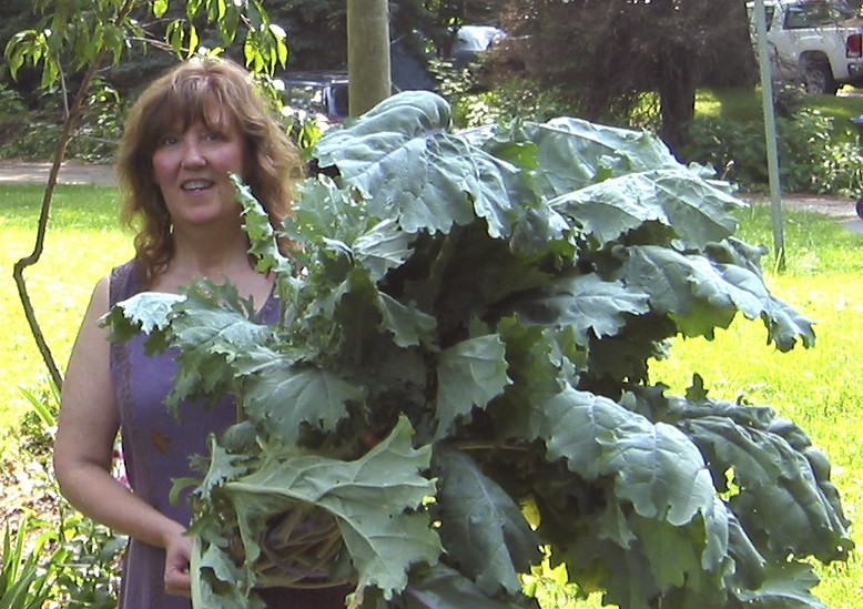 Debby with the largest single kale plant she has grown to date