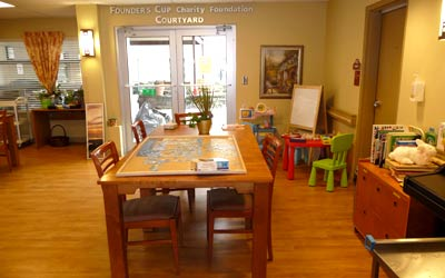 Common area dining room and children's play area