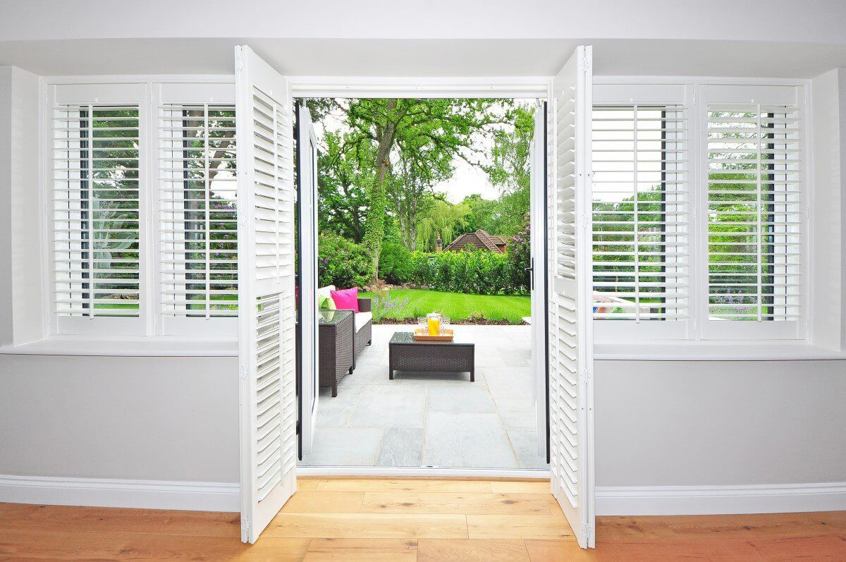 white shutters and doors to backyard - Home