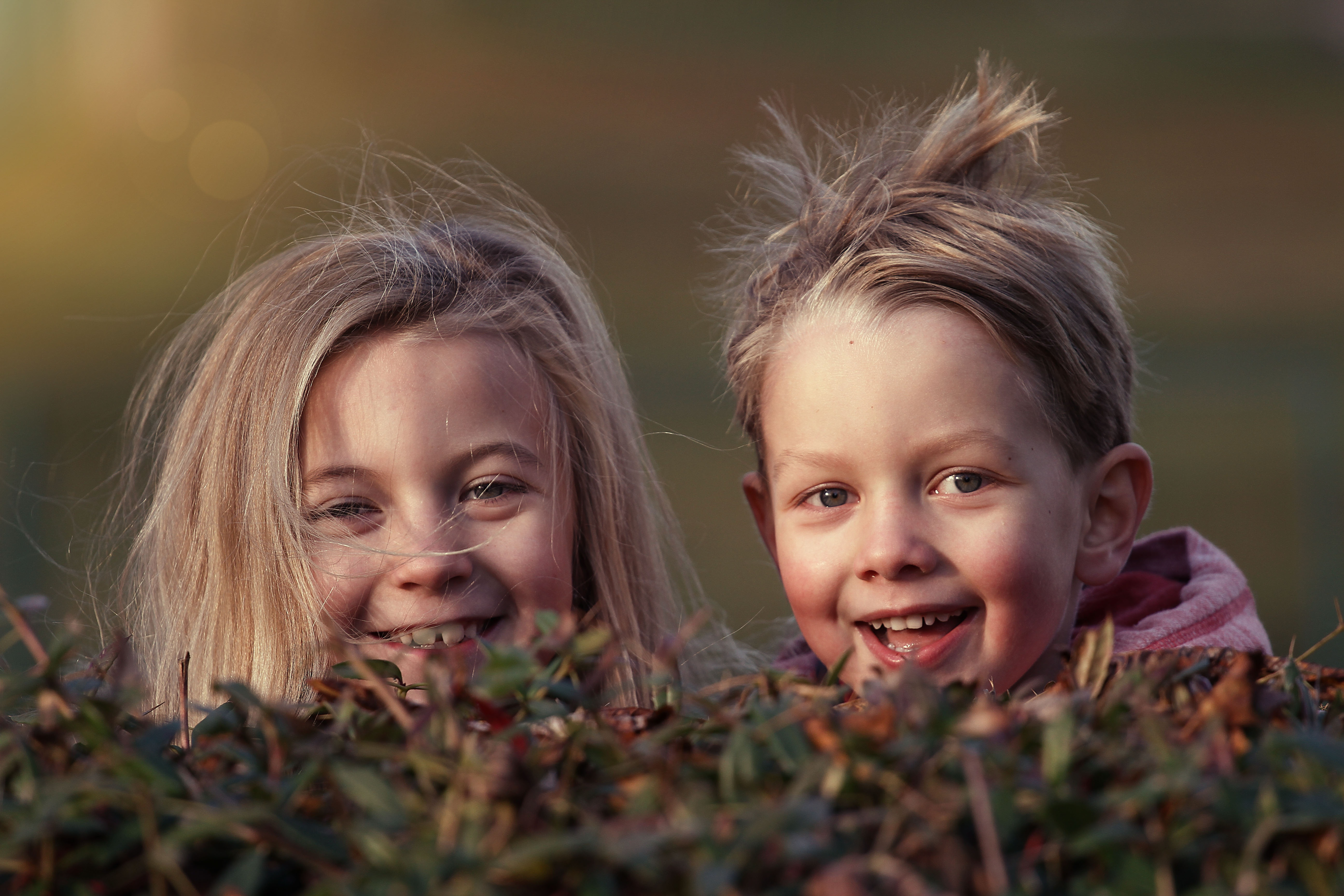 Canva - Children Laughing Outdoors