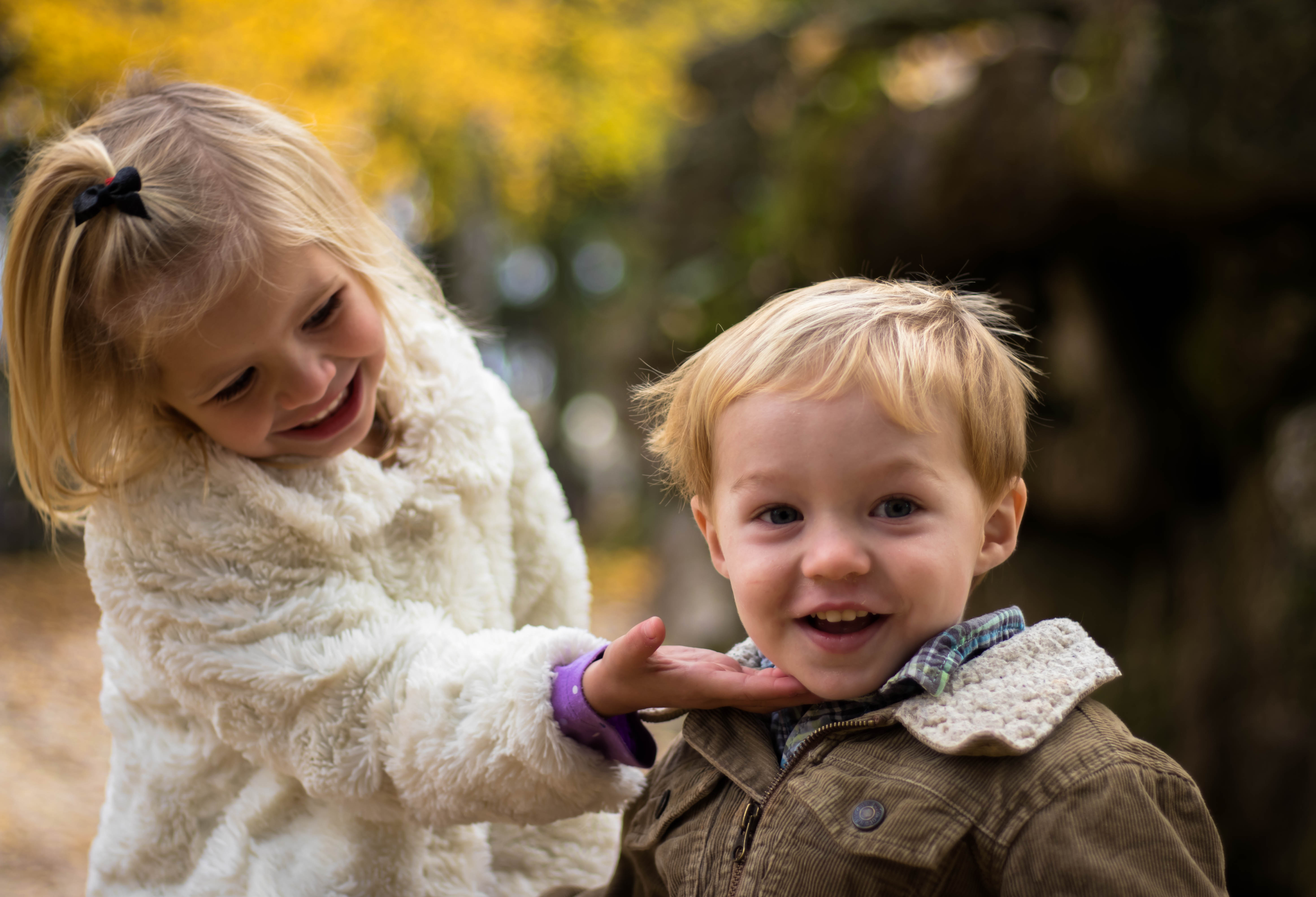 Canva - Girl Holding the Chin of Boy Outdoor