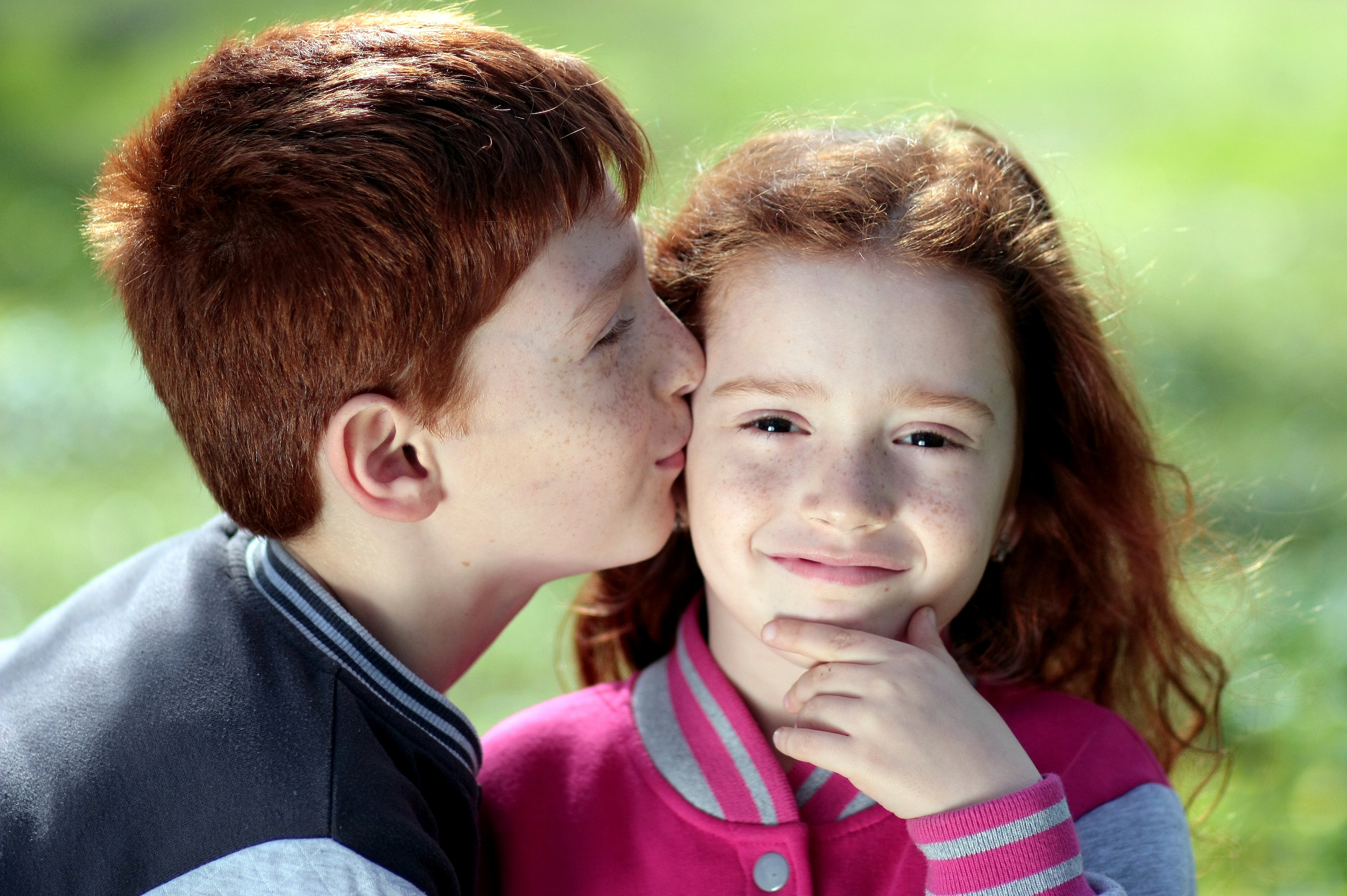 Canva - Young Boy Kissing Girl