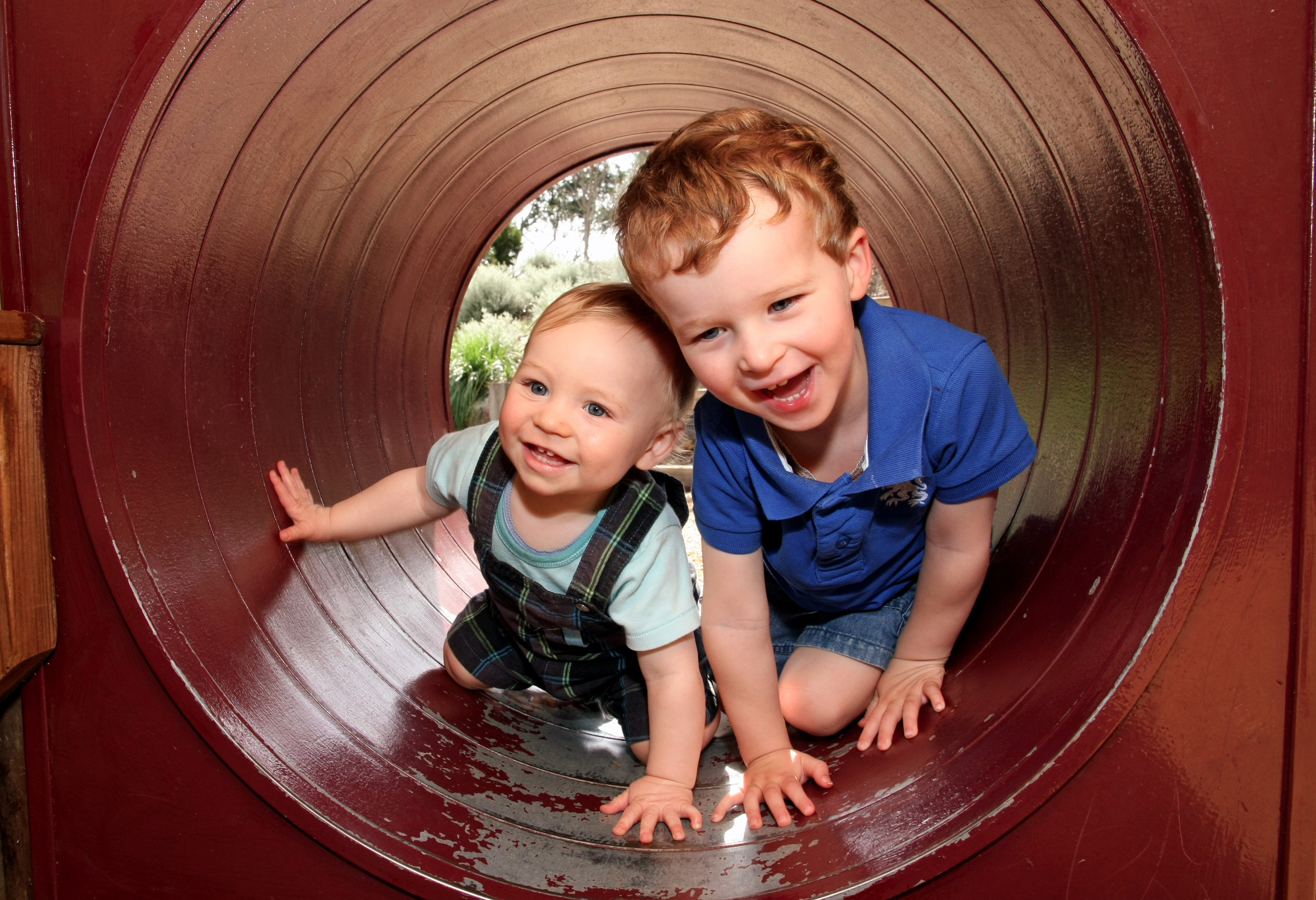 Canva - Young Brothers Playing - Copy