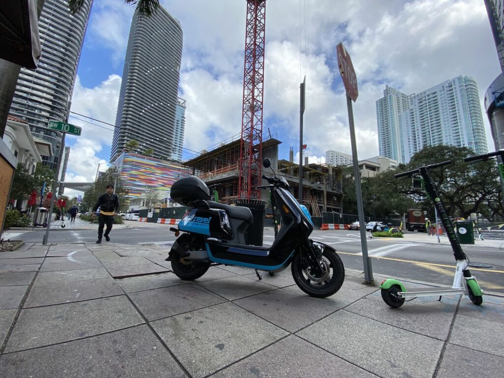 This an image of an electric scooter parked illegally on the sidewalk