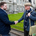 (24/04/16. No Repro Fee) *** Easter Rising Families Reconcile after 100 Years *** Patrick McHugh born in Cairns, North Queensland, Australia and Raymond Keogh from Bray, County Wicklow met at Trinity College today 23rd April in advance of the unveiling of a plaque by Dublin City Council (on Monday 25th April 2016) to commemorate the death of Irish Volunteer Gerald Keogh, Raymond's grand-uncle, who was shot outside Trinity College on 24th April 1916, reputedly by Australian soldier (Anzac trooper) Mick McHugh, great-great-uncle of Patrick, during the Easter Rising 1916. Irish Volunteer Gerald Keogh and Australian trooper Mick McHugh were both young soldiers of the same age (22) but on opposite sides in the 1916 Rising. Mick was ordered to defend Trinity College during Easter week. Mick is reputed to have killed Gerald while the Irish Volunteer was carrying out direct orders from Patrick Pearse. PICTURED: Patrick McHugh and Raymond Keogh meet for the first time in front of the tower in Trinity college where it is alleged that Patrick's great great uncle shot Raymond's grand-uncle outside Trinity College on 24th April 1916. PIC: Joe Keogh.