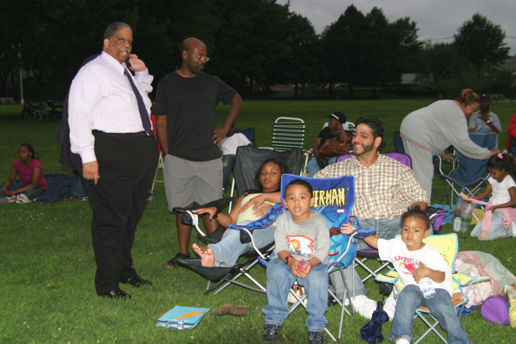 Then Council Member Leroy Comrie greeting Family Movies in the Park attendees.
