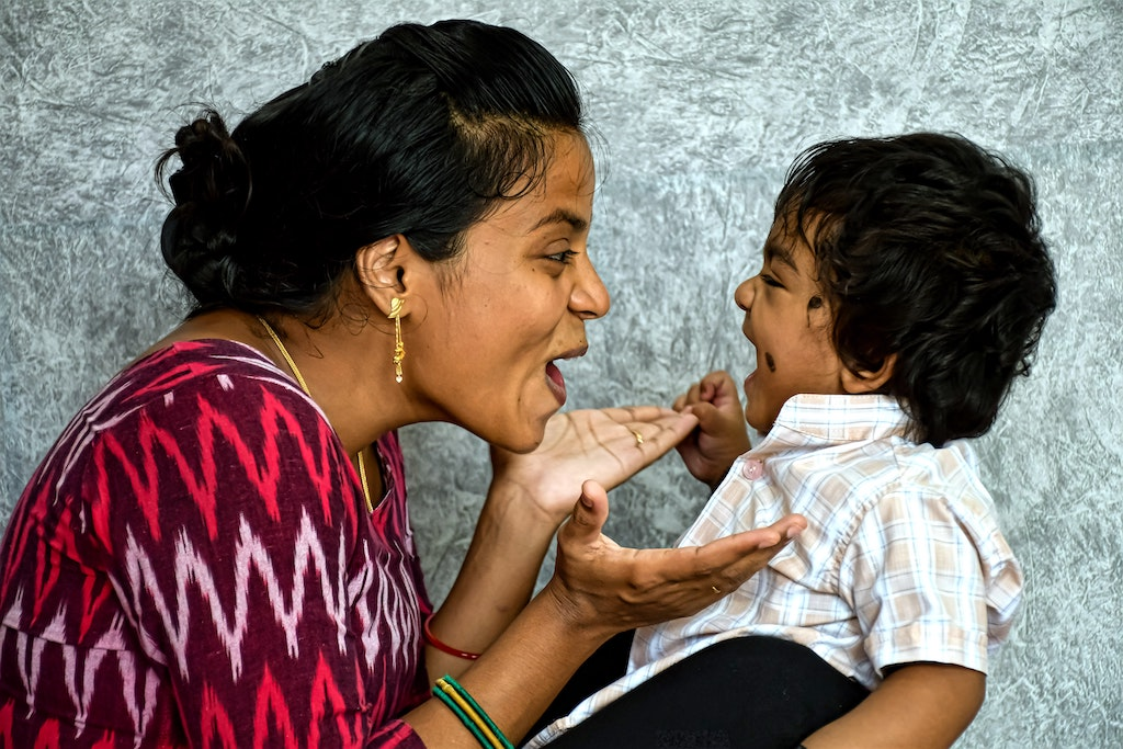 Mother making her child with Autism laugh.