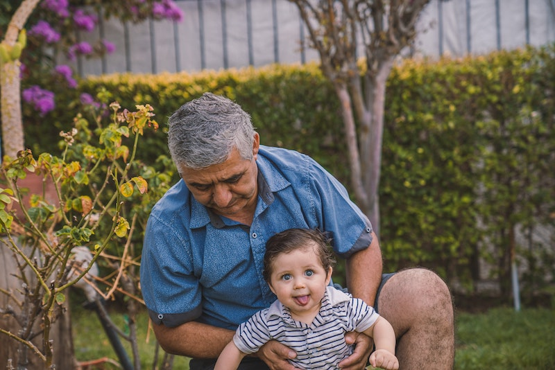 Grandfather living with kidney disease playing with his grandson.