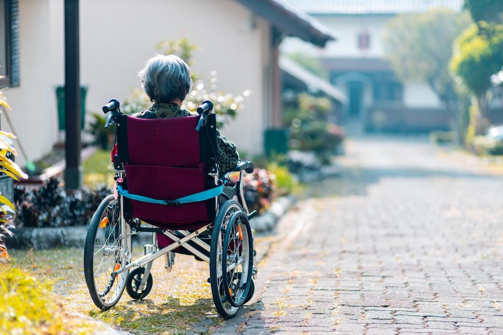 Home care recipient sitting in wheelchair.