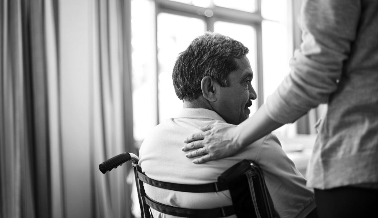 Shot of a young nurse caring for a senior man in a retirement home