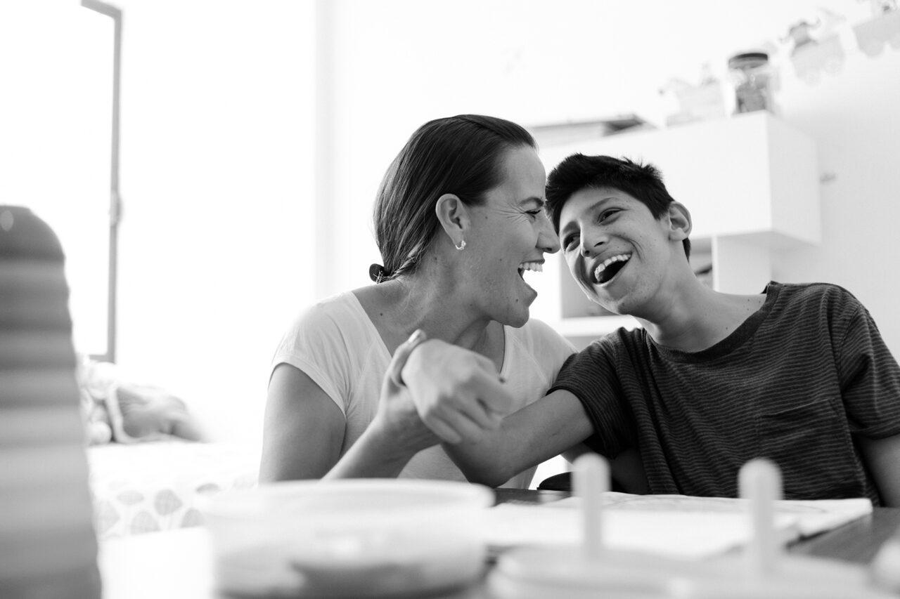 Mother playing with son with Cerebral Palsy