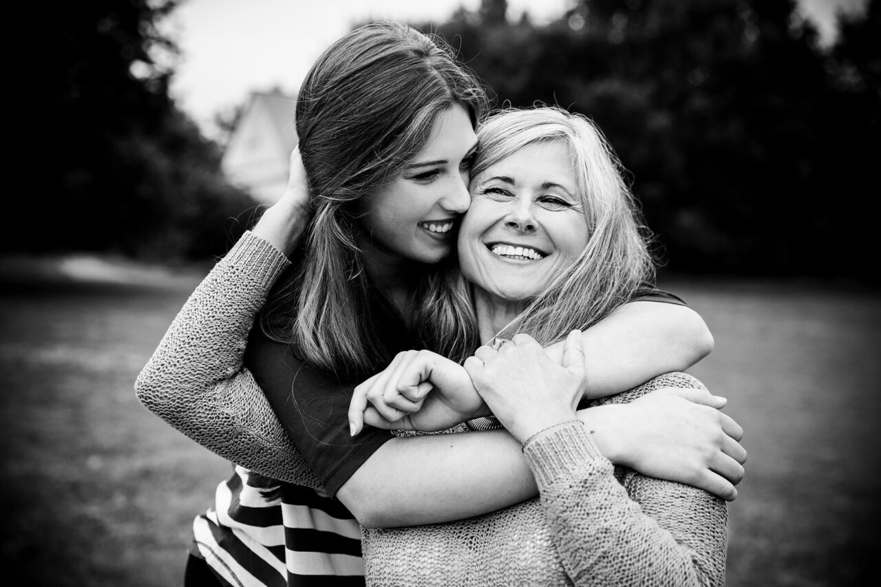 Daughter Surprises Mother With a Hug From Behind