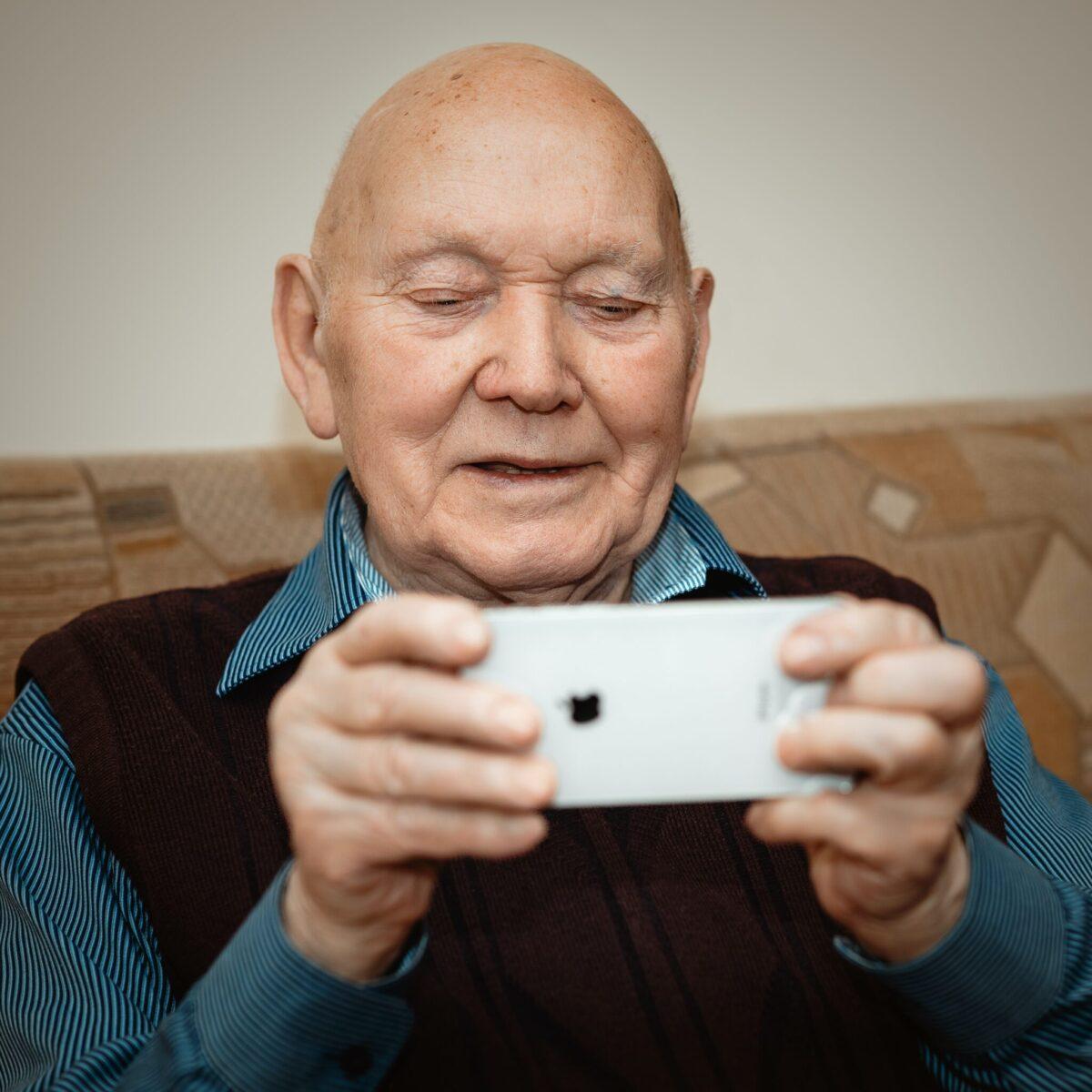 Senior-Citizen-Using-Mobile-Phone