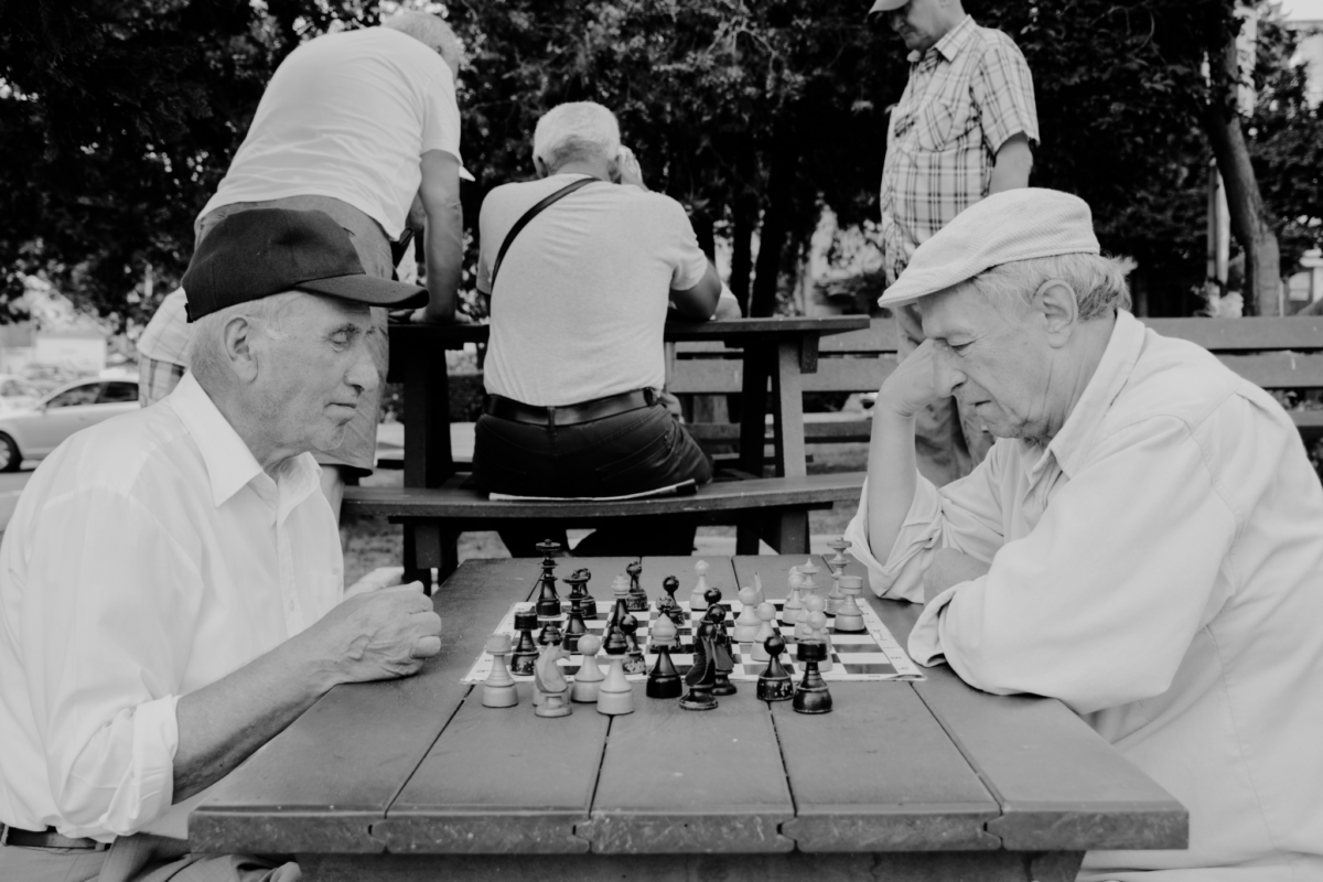 Men playing chess in the park