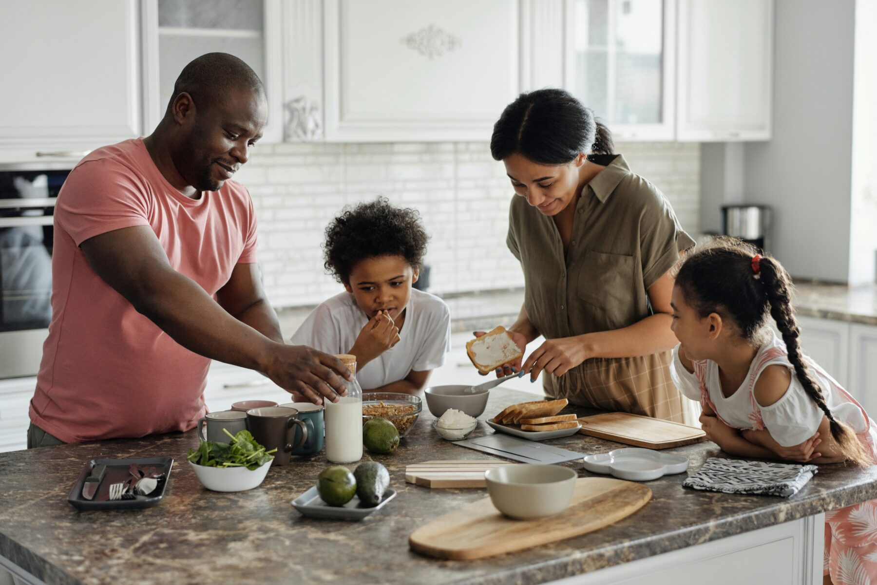 Young family preparing dinner together.