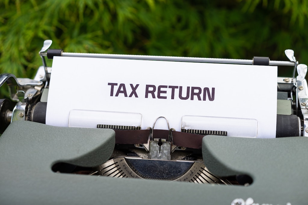 Typewriter with Tax return typed on paper; Tax Rules for Family Caregivers