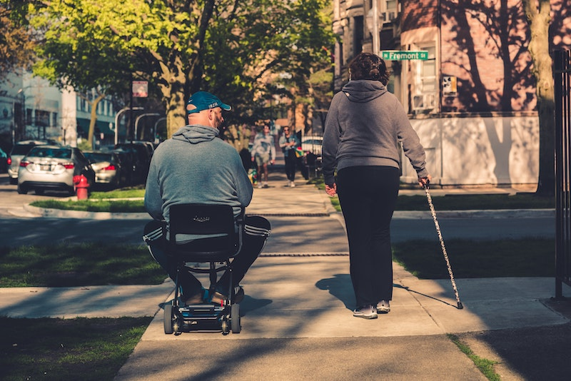 Older man and woman living with Multiple Sclerosis
