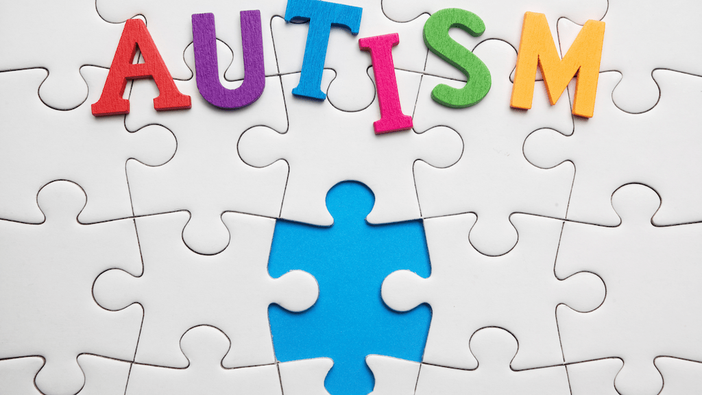 Puzzle with the word Autism in colors and one piece is missing.