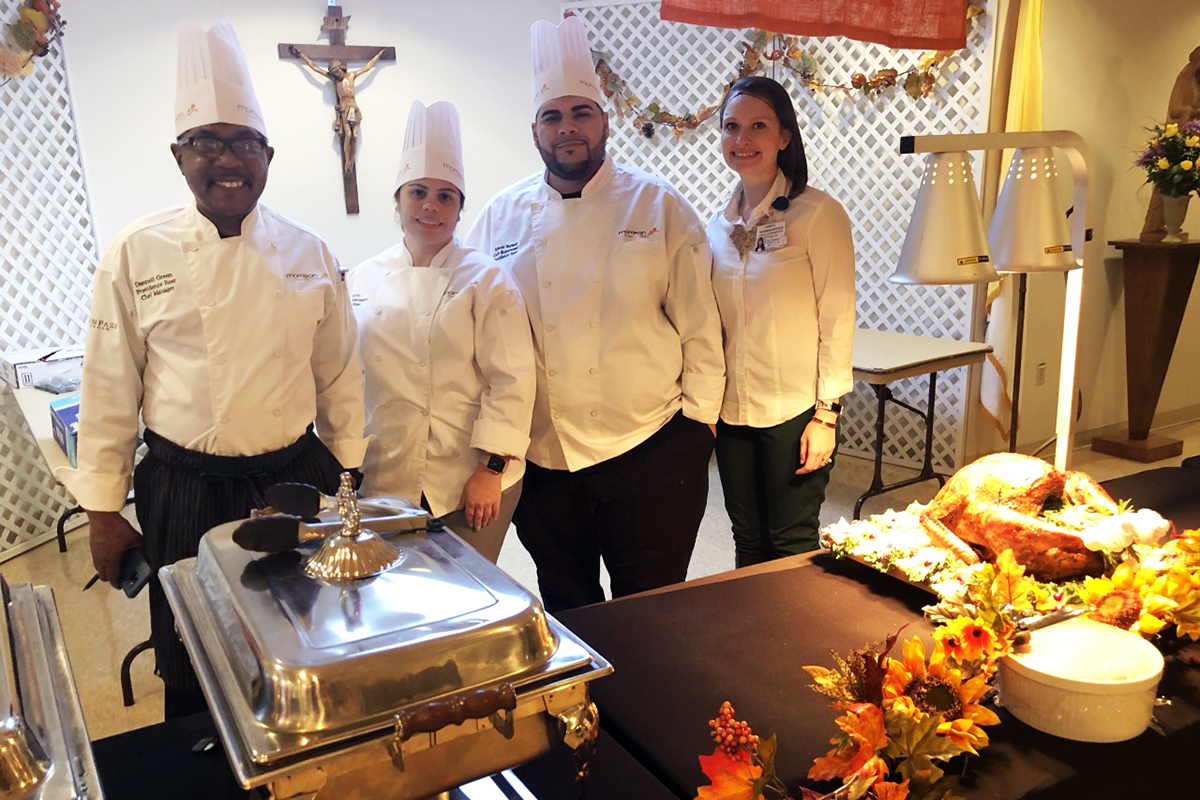 Providence Rest Chefs serving food in chafing dishes.