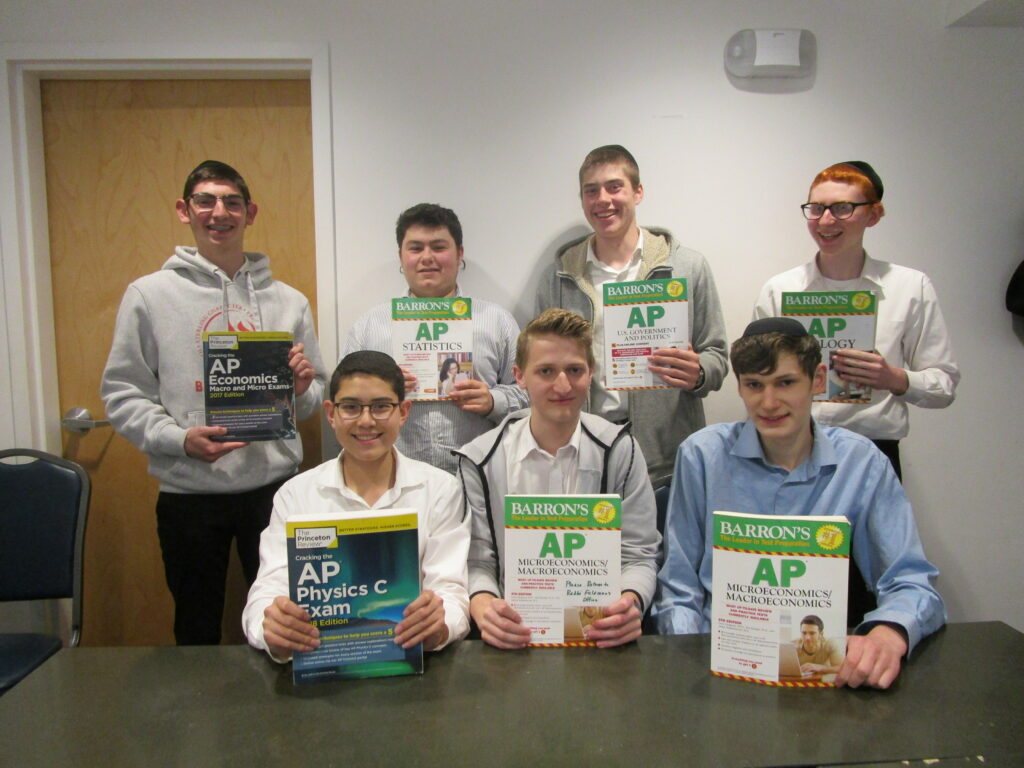 students holding ap course textbooks