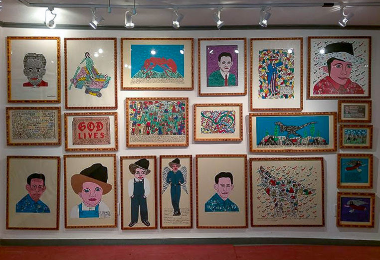 wall of howard finster serigraphs, vision house museum permanent collection