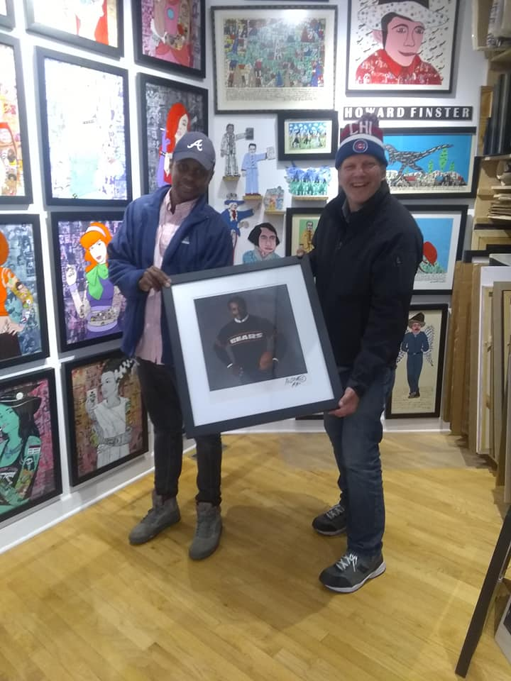 happy art buyer with walter payton marc hauser photograph