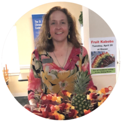 Activity Director Aimee Minton with fruit kebabs for a past senior activity