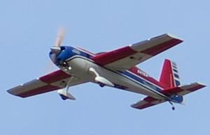 photo of modal plane zipping overhead.