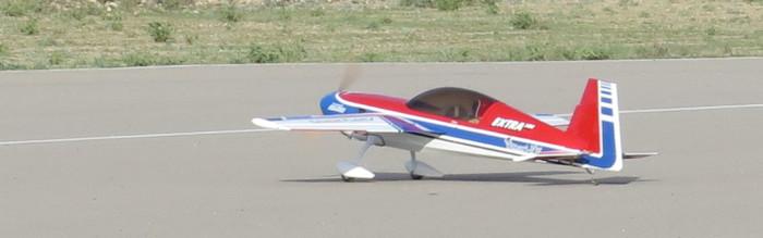 photo of Jim's Extra 300 aerobatic plane starting take off.
