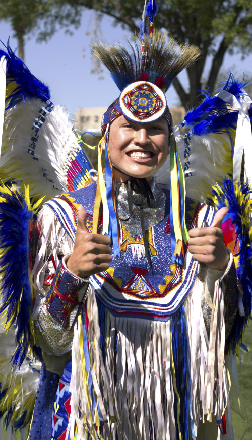 Woman dressed in traditional Native American clothing.