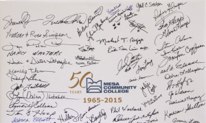 Students and faculty sign a commemorative board