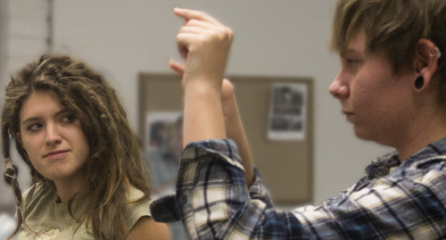 MCC students Jynna Johnson and Kate Woodworth practice sign language in Marino's ASL class. Photos by Tania Ritco/Mesa Legend