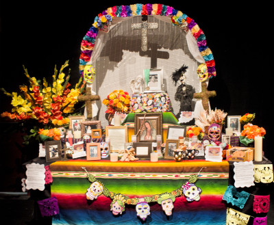 To celebrate Dia De Los Muertos, altars were constructed at the Mesa Arts Center that contain pictures of lost loved ones, their favorite foods, flower and candles. Tania Ritko/ Mesa Legend