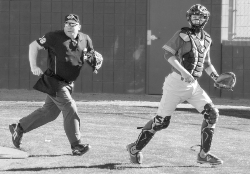 MCC catcher and umpire walking to the dugout during inning change. Photo: Tania Ritko/Mesa Legend