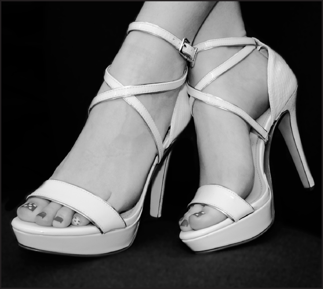 Photo of feet in high heels. Despite how attractive high heels can be, they can cause long term damage to the Achilles tendon and bone alignment.