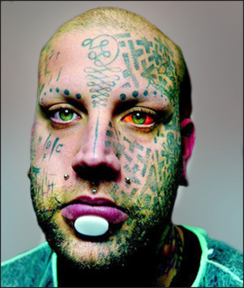 Photo of man with tattoos on his face.