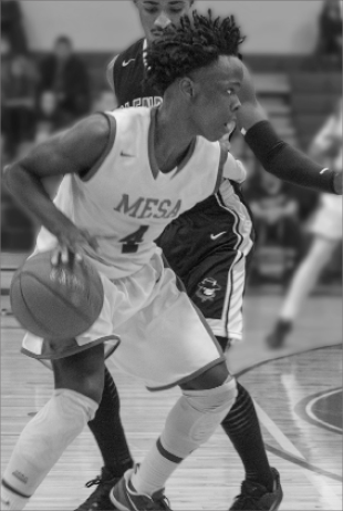 Mesa guard Obi Megwa posting up a defender as an attempt to score. Megwa finished the night with 15 points on 5-10 shooting 2 assists with a team high 4 steals and 3 rebounds.