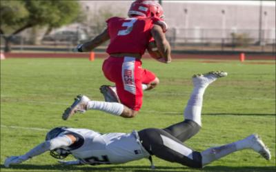 Mesa Wide reciever #3, Darius Aguirre leaping over a Lackawanna defender.