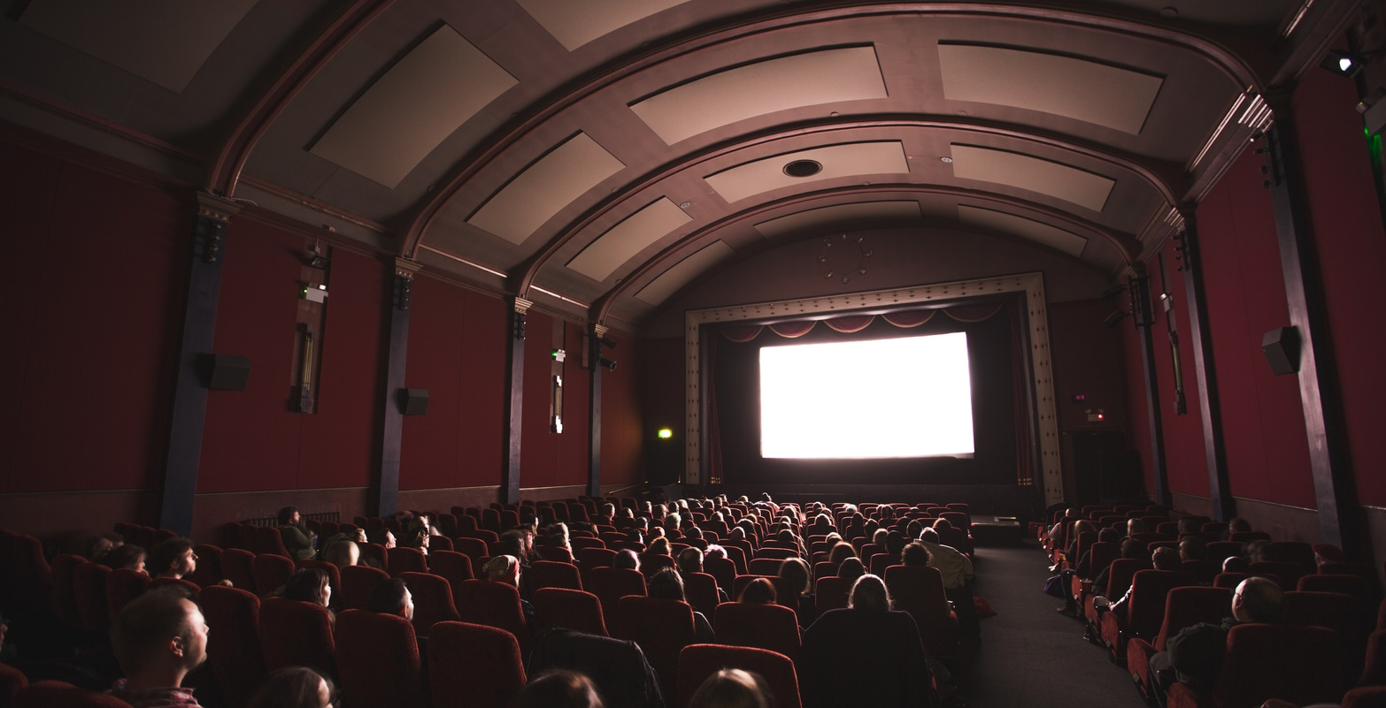 Movie theaters return masked up.