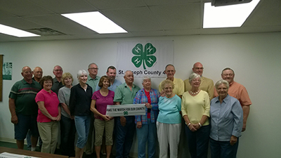 The St. Joseph County 4-H Make the Match leadership donors and committee members were recognized in June. Pictured (L to R) are: Tony Hochstetler, Fred Henningsen, Eva Beeker, Dale Stuby, Wendy Walters, Lynn Fiegel, James Eley, Deanna and Dave Mumby, Jack and Kathleen Hensell, Beverly and David Sturgis, Susan Outman, Kurt Inman (representing Sturgis Bank and Trust Company), Sally Stuby and Monte Bordner.