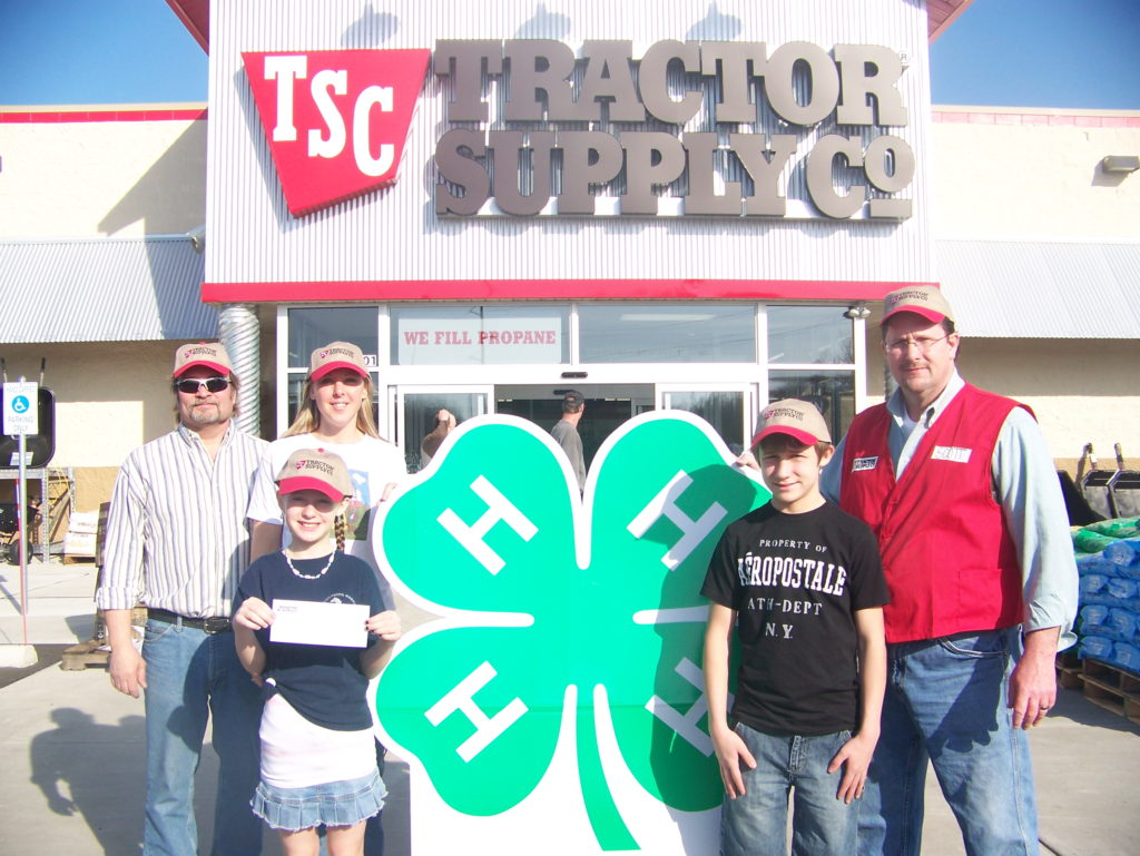 4-H members and Tractor Supply Co. representatives in front of the TSC store in Petoskey, Mich.