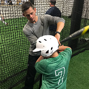 Brent works on batting form with a member of the Woodinville Little League