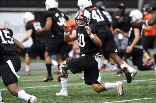 Oregon State University Football's Drew Kell Stretches with Team
